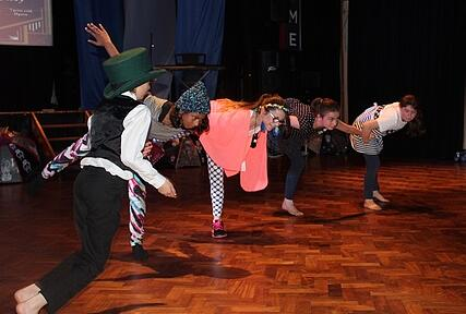 Young people flying in production of Peter Pan