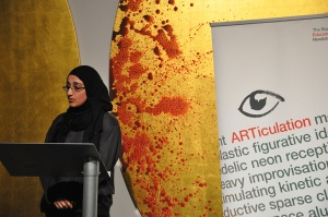2015 ARTiculation Prize participant presenting at the Ikon Gallery, Birmingham in front of Imran Qureshi, They Shimmer Still (detail), 2013