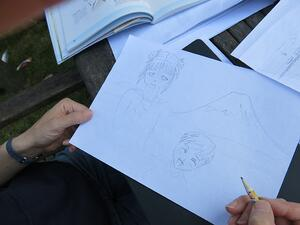 Silver drawing workshops taking place at home with family members