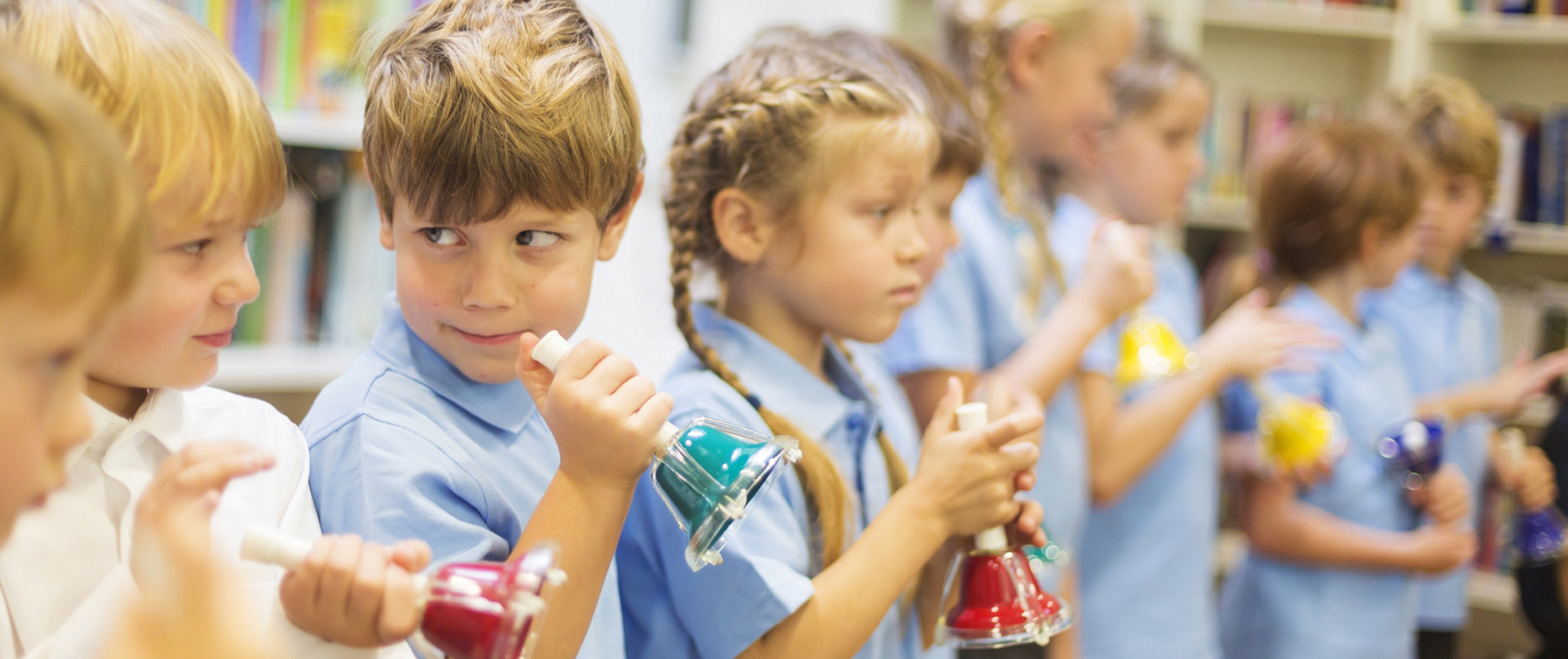School children are lined up ready to play hand bells